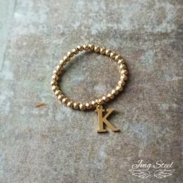 Złoty pierścionek na gumce...