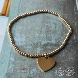 Złota bransoletka na bumce z sercem