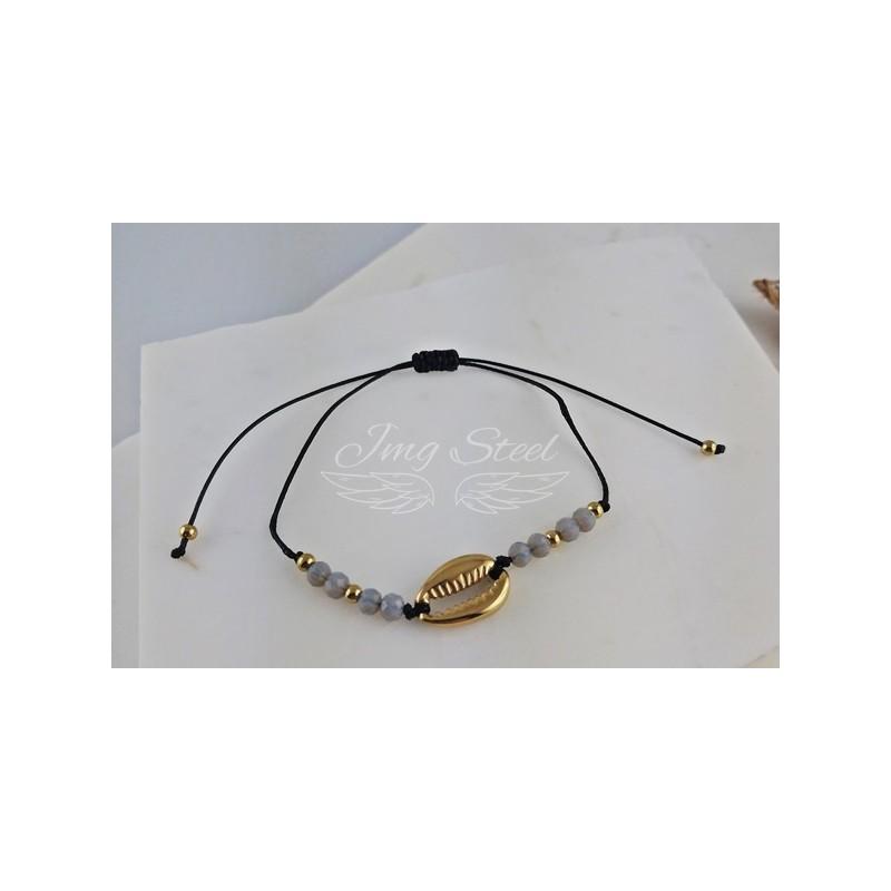Czarna bransoletka ze złotą muszlą